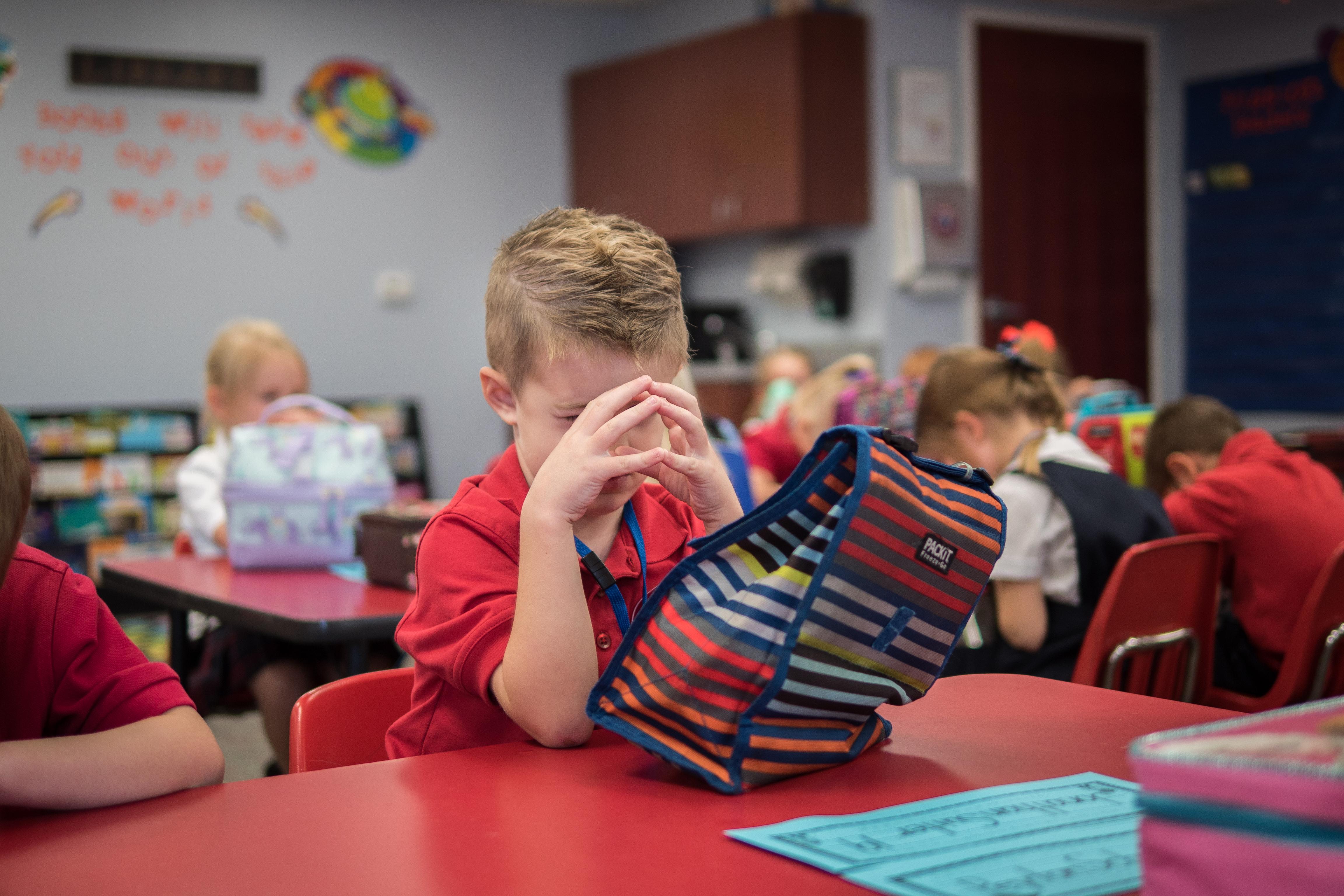 Elementary Student Praying